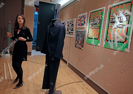Stock Photo of A two piece suit in navy blue, worn by Sid Vicious at a court appearances circa 1978, is put on display for the media ahead of a Pop and Rock memorabilia sale at Christie's in London . The court appearances included one for drug offences as well as the inquest in to the murder of his girlfriend Nancy Spungen. The sale is estimated to start between 10,000 and 15,000 pounds (11,600 and 17,446 euro