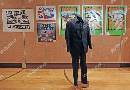 A two piece suit in navy blue, worn by Sid Vicious at a court appearances circa 1978, is put on display for the media ahead of a Pop and Rock memorabilia sale at Christie's in London . The court appearances included one for drug offences as well as the inquest into the murder of his girlfriend Nancy Spungen. The sale is estimated to start between 10,000 and 15,000 pounds (11,600 and 17,446 euro