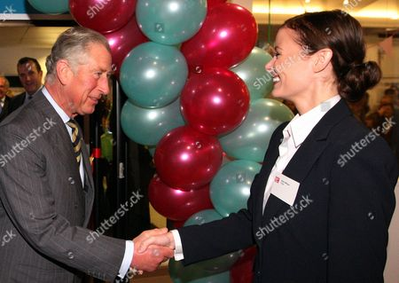 Britain's Prince Charles, left, President, Business in the Community, meets with Helen Milligan, right, local and national business leaders and the first Business Connectors at the opening of a new Start-Up Shop in The Mall in Middlesbrough, England, The Prince of Wales return's to Teesside to see for himself the progress being made by a number of regeneration projects which he has helped to inspire in the area