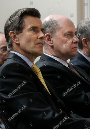 The Director General of the British domestic security and counter-intelligence service MI5 Jonathan Evans, right, sits beside the head of the British foreign intelligence service, the Secret Intelligence Service (SIS), MI6, Sir John Sawers, left, as they listen in the front row of the audience during a speech by Britain's Foreign Secretary William Hague at the Foreign Office in London, . Hague's speech was on Secret Intelligence, praising the work of agencies, stressing the importance of framework of law, values and accountability