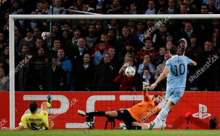Villarreal's Carlos Marchena, left, scores an own goal past his goalkeeper Diego Lopez during their Champions League Group A soccer match against Manchester City at The Etihad Stadium, Manchester, England