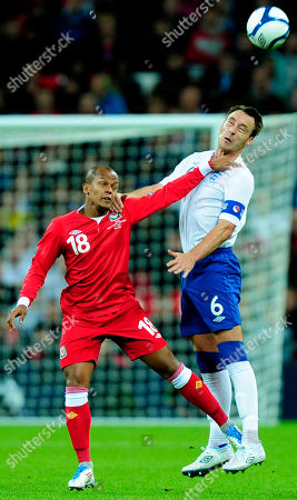 John Terry, Robert Earnshaw England's John Terry, right, jumps for the ball with Wales' Robert Earnshaw during their Euro 2012 Group G qualifying soccer match at Wembley Stadium, London