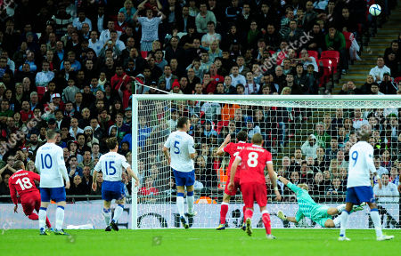 Robert Earnshaw Wales' Robert Earnshaw, left, shoots high over the bar during their Euro 2012 Group G qualifying soccer match against England at Wembley Stadium, London