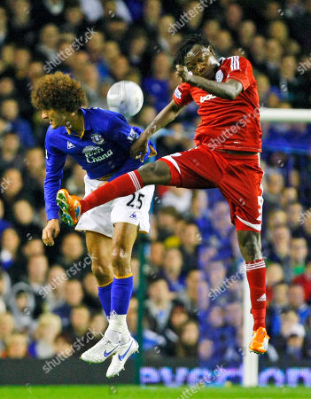 Somen Tchoyi, Marouane Fellaini Everton's Marouane Fellaini, left, vies for the ball against West Bromwich Albion's Somen Tchoyi during their English League Cup third round soccer match at Goodison Park, Liverpool, England