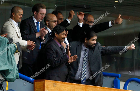Stock Image of Balaji Rao, Venkatesh Rao Blackburn Rovers' Indian owners Balaji Rao, right, and brother Venkatesh Rao celebrate after defeating Arsenal in their English Premier League soccer match at Ewood Park, Blackburn, England