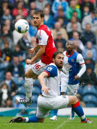 Gael Givet, Aaron Ramsey Arsenal's Aaron Ramsey, left, vies for the ball against Blackburn Rovers' Gael Givet during their English Premier League soccer match at Ewood Park, Blackburn, England