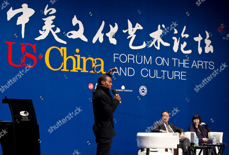 "Charles ""Lil Buck"" Riley, Ma Yo-Yo, Amy Tan American artist Charles ""Lil Buck"" Riley speaks as French-born American cellist Ma Yo-Yo, second right, and American writer Amy Tan, right, look on during a forum on ""the U.S.-China arts and culture"" at National Center for the Performing Arts in Beijing, China"