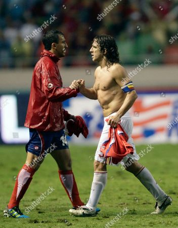 Spain's Carles Puyol, right, greets Randall Azofeifa, left, at the end of their friendly soccer match in San Jose, Costa Rica, . COsta Rica and Spain tied 2-2