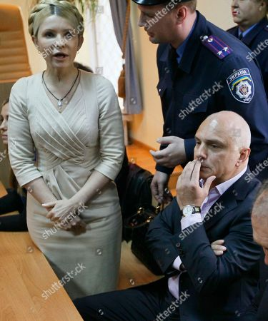 Oleksandr Tymoshenko Oleksandr Tymoshenko, bottom right, husband of former Ukrainian Prime Minister Yulia Tymoshenko listens as she speaks during her trial at the Pecherskiy District Court in Kiev, Ukraine. A senior Czech official said Friday Jan 6,. 2012 the husband of jailed former Ukrainian Prime Minister Yulia Tymoshenko is seeking political asylum in the Czech Republic