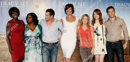 """Viola Davis, Octavia Spencer, Tate Taylor, Allison Janney, Kathryn Stockett, Emma Stone, Mike Vogel Left to right, U.S actress Viola Davis, U.S actress Octavia Spencer, U.S Director Tate Taylor, U.S actress Allison Janney, U.S screenwriter Kathryn Stockett, U.S actress Emma Stone, and U.S actor Mike Vogel pose for a photocall for their film """"The Help"""" during the 37th American Film Festival in Deauville, Normandy, France"""