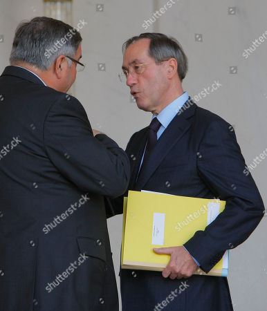 French interior Interior Minister Claude Gueant, right, talk to Justice Minister Michel Mercier at the Elysee palace following the weekly cabinet meeting between the French President Nicolas Sarkozy