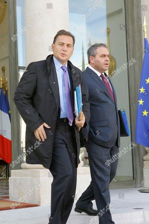 French Industry Minister Eric Besson, left, with Labor and health Minister Xavier Bertrand leaves the Elysee palace following the weekly cabinet meeting with the French President Nicolas Sarkozy
