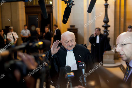 Stock Picture of Georges Kiejman One of Jacques Chirac's lawyers Georges Kiejman gestures as he answers reporters at the Paris courthouse for Chirac's trial, . Former French president Jacques Chirac's corruption trial resumed Monday with his lawyers saying he won't be able to attend it as he is suffering severe memory lapses possibly related to a stroke