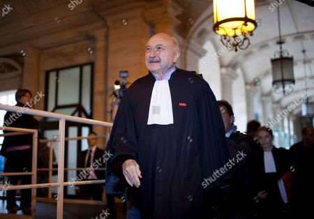 One of Jacques Chirac's lawyers Georges Kiejman arrives at the Paris courthouse for Chirac's trial, . A corruption trial in which French former president Jacques Chirac is the star defendant resumes Monday, and the 78-year old won't appear while his lawyers argue that he's not well enough to attend