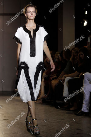 A model wears a creation by French fashion designer Martine Sitbon for her spring-summer 2012 ready to wear collection in Paris