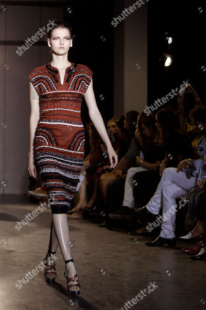 A model wears a creation by French fashion designer Martine Sitbon for her spring-summer 2012 ready to wear collection presented, in Paris