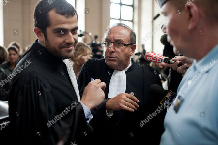 Aurelien Hamelle, Yves Beddouk Former Dior designer John Galliano's lawyer Aurelien Hamelle, left, and defendant lawyer Yves Beddouk are seen at a Paris court house, . A Paris court has convicted former Christian Dior designer John Galliano for making anti-Semitic insults and gave him a suspended sentence and a fine of 6,000 euro ($8,400