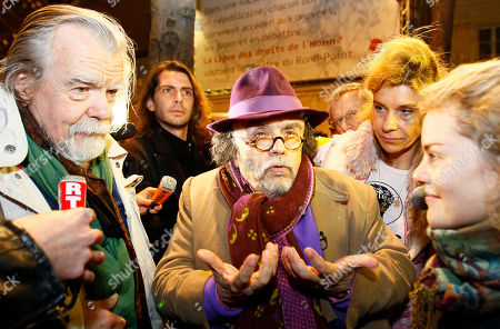 "Jean Michel Ribes, Michael Lonsdale Jean Michel Ribes, center, director of Rond Point Theatre, flanked with actor Michael Lonsdale, left, speaks to the media as Christian fundamentalists hold a demonstration, in Paris, front of the Rond Point Theatre where Argentinian author Rodrigo Garcia's play ""Golgota Picnic"" is being performed, claiming it is blasphemous"