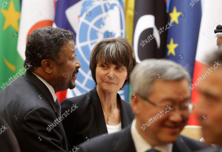 Swiss President Micheline Calmy-Rey, center, listens to Jean Ping, left, head of the African Union, during the group photo at the Elysee Palace in Paris, Thursday, Sept.1, 2011. Heads of state and top officials gather in Paris to work out how to support Libya's opposition leaders after Gadhafi's fall from power