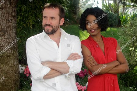 """Sara Martins, Ben Miller French actress Sara Martins and British actor and comedian Ben Miller pose as they launche a new drama series """"Death in Paradise"""" during the 27th MIPCOM (International Film and Programme Market for Tv, Video,Cable and Satellite) in Cannes, southeastern France"""