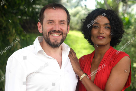 """French actress Sara Martins and British actor and comedian Ben Miller pose as they launch a new drama series """"Death in Paradise"""" during the 27th MIPCOM (International Film and Programme Market for TV, Video,Cable and Satellite) in Cannes, southeastern France"""