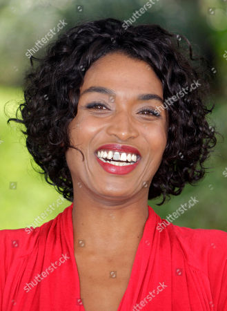 """Sara Martins French actress Sara Martins poses as she launches a new drama series """"Death in Paradise"""" during the 27th MIPCOM (International Film and Programme Market for Tv, Video,Cable and Satellite) in Cannes, southeastern France"""