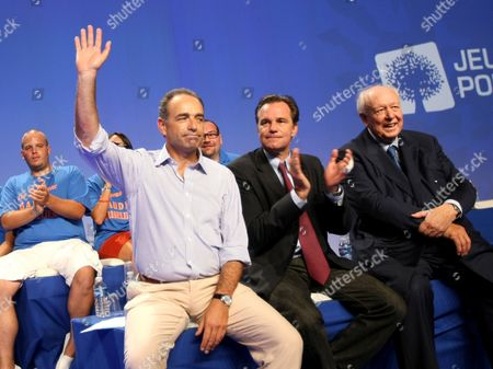 Jean-Francois Cope, Jean-Claude Gaudin, Renaud Muselier Jean-Francois Cope, left, head of the ruling UMP conservative party, waves to militants during the party's summer convention in Marseille, southern France, Friday, Sept.2, 2001. At right is Marseille mayor Jean-Claude Gaudin, and second right, parliament member Renaud Muselier