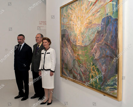 """Queen Sonja, Frederic Mitterand, Alain Seban Queen Sonja of Norway, third from left, French Minister of Culture, Frederic Mitterand, second from left, and curator of French national museums Alain Seban pose in front of a painting by Norwegian artist Edvard Munch called """"The Sun"""", at the Centre Pompidou, in Paris"""