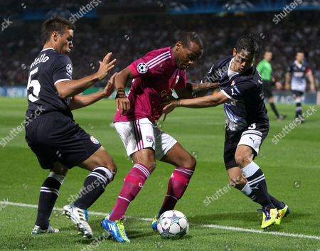 Stock Photo of Jimmy Briand, Adrian Daniel Callelo, Luis Ibanez Lyon's French forward Jimmy Briand, center, challenges for the ball with Dinamo Zagreb's Argentinian midfielder Adrian Daniel Callelo, left,and Argentinian defender Luis Ibanez, during their Champions League Group D, soccer match, at the Gerland Stadium, in Lyon, central France