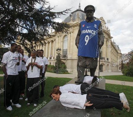 Joakim Noah France's Sport Minister, Chantal Jouanno, for ground, poses with the French National baseball team next to the Winston Churchill statue, dressed with the national shirt, to mark the upcoming Summer Olympic games in London 2012, in Paris, Sept. 19, 2011. France silver medalist, lost against Spain in the EuroBasket European Basketball Championship final in Kaunas, Lithuania