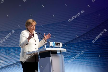 German Chancellor Angela Merkel delivers a speech at the annual conference of the Federation of German Industry (BDI) in Berlin, central Germany, . Merkel and Greek Prime Minister Georgios Papandreou spoke at the conference about their economic policy and the financial crisis