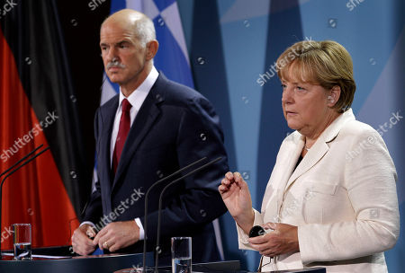German Chancellor Angela Merkel, right, and the Prime Minister of Greece, Georgios Papandreou, left, adress the media prior to a dinner at the chancellery in Berlin, Germany