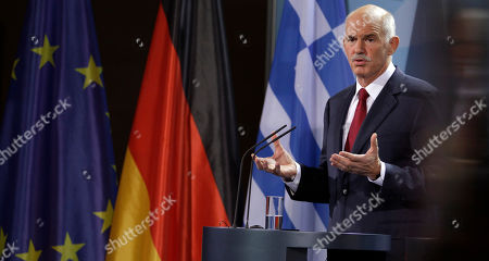 The Prime Minister of Greece, Georgios Papandreou, addresses the media during a joint statement with German Chancellor Angela Merkel prior to a dinner at the chancellery in Berlin, Germany
