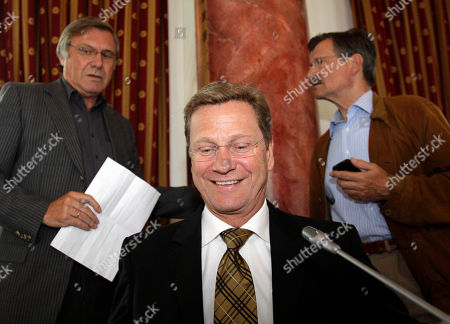 Guido Westerwelle German Foreign Minister Guido Westerwelle, center, opens a party meeting of the Free Democratic Party in Bergisch-Gladbach, Germany, . In background left is Wolfgang Gerhardt and right Hermann Otto Solms. Westerwelle denies rumors that he will step down from his post