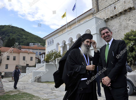 Greek Foreign Minister Stavros Lambrinidis, right, and chief abbot Varnavas are seen in the semiautonomous Mount Athos monastic community in northern Greece, on . Prime Minister George Papandreou is due to visit Mount Athos on Saturday, where he will met with Ecumenical Patriarch Vartholomaios, but financial rather than spiritual matters could top the agenda after the Church of Greece suggested that it might want to make a bigger contribution to public coffers