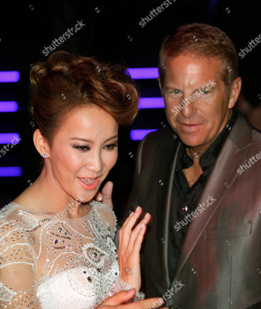 Coco Lee, Bruce Rockowitz Hong Kong's pop diva Coco Lee, left, poses with her husband, Bruce Rockowitz, president of Li & Fung Ltd., during their wedding banquet at Shaw Studio in Hong Kong, China, . Singer Coco Lee married business tycoon Rockowitz on Thursday, Oct. 27