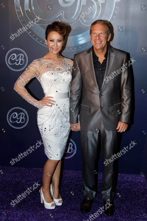Coco Lee, Bruce Rockowitz Hong Kong's pop diva Coco Lee, left, and her husband Bruce Rockowitz, president of Li & Fung Ltd., pose during their wedding banquet at Shaw Studio in Hong Kong, China, . Singer Coco Lee married business tycoon Rockowitz on Thursday, Oct. 27