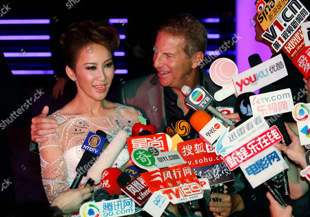 Coco Lee, Bruce Rockowitz Hong Kong's pop diva Coco Lee and her husband, Bruce Rockowitz, president of Li & Fung Ltd, speak to media during their wedding banquet at Shaw Studio in Hong Kong . Singer Coco Lee married business tycoon Rockowitz on Thursday, Oct. 27