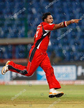 Stock Photo of Ravi Rampaul Trinidad and Tobago bowler Ravi Rampaul runs to celebrate the dismissal of Mumbai Indians batsman Andrew Symonds, not seen, during their Champions League Twenty20 cricket match in Bangalore, India