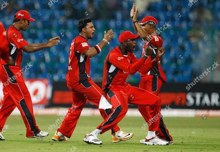 Ravi Rampaul Trinidad and Tobago bowler Ravi Rampaul, second left, celebrates with teammates the dismissal of Mumbai Indians batsman Andrew Symonds, not seen, during their Champions League Twenty20 cricket match in Bangalore, India