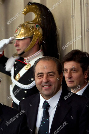 Antonio Di Pietro Italy of Values party leader Antonio Di Pietro walks past a Cuirassier presidential guard as he leaves the Quirinale Presidential Palace in Rome after talks with Italian President Giorgio Napolitano, . Berlusconi resigned after the Parliament's lower chamber passed European-demanded reforms, ending a 17-year political era and setting in motion a transition aimed at bringing Italy back from the brink of economic crisis