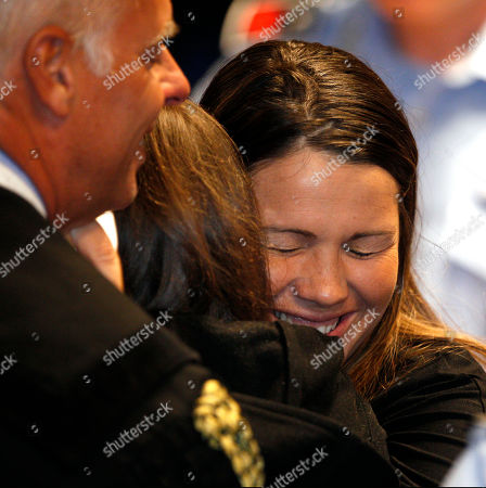 Amanda Knox Italian lawyer lawyer Maria Del Grosso, right, hugs Amanda Knox after the verdict that overturns her conviction and acquits her of murdering her British roommate Meredith Kercher, at the Perugia court, central Italy, . Italian appeals court threw out Amanda Knox's murder conviction Monday and ordered the young American freed after nearly four years in prison for the death of her British roommate. Knox collapsed in tears after the verdict overturning her 2009 conviction was read out. Her co-defendant, Italian Raffaele Sollecito, also was cleared of killing 21-year-old Meredith Kercher in 2007. At left is Amanda's other lawyer Carlo Dalla Vedova