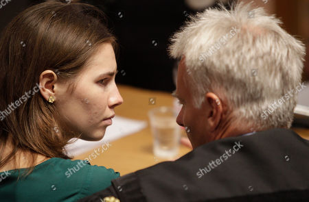 Amanda Knox Amanda Knox talks to her lawyer Carlo Dalla Vedova prior to an appeal hearing, at the Perugia court, central Italy, . Knox, an American student, was convicted of sexually assaulting and murdering Meredith Kercher, her British roommate in Perugia, and sentenced to 26 years in prison. Knox's boyfriend at the time of the 2007 murder, Raffaele Sollecito of Italy, was convicted of the same charges and sentenced to 25 years. Both deny wrongdoing and have appealed the December 2009 verdict