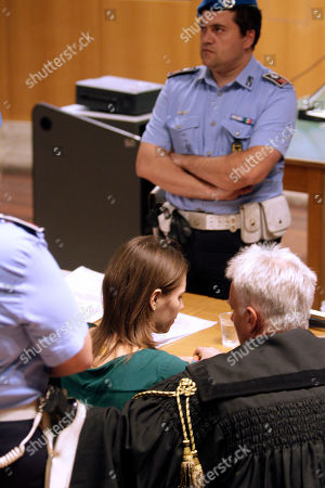 Amanda Knox Amanda Knox, front left, talks to her lawyer Carlo Dalla Vedova prior to an appeal hearing at the Perugia court, central Italy, . The 24-year-old Knox looked tense as she entered a packed courthouse. She is expected to address the court in a final plea of her innocence. A verdict is expected later Monday