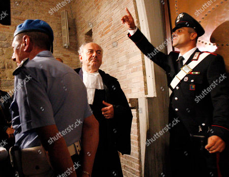 Prosecutor Giuliano Mignini, center, arrives in Perugia court, central Italy, to attend an appeal hearing of Amanda Knox and Raffaele Sollecito. The 24-year-old Knox looked tense as she entered a packed courthouse. She is expected to address the court in a final plea of her innocence. A verdict is expected later Monday