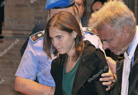 Amanda Knox, accompanied by her lawyer Carlo Dalla Vedova, arrives for an appeal hearing at the Perugia court, central Italy, . Knox, an American student, was convicted of sexually assaulting and murdering Meredith Kercher, her British roommate in Perugia, and sentenced to 26 years in prison. Knox's boyfriend at the time of the 2007 murder, Raffaele Sollecito of Italy, was convicted of the same charges and sentenced to 25 years. Both deny wrongdoing and have appealed the December 2009 verdict