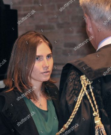 Amanda Knox talks with her lawyer Carlo Dalla Vedova upon arrival for an appeal hearing at the Perugia court, central Italy, . A tearful Amanda Knox has told an appeals court in Italy that accusations that she killed her British roommate are unfair and groundless. Knox fought back tears as she addressed the court Monday, minutes before the jury went into deliberations to decide whether to uphold her murder conviction. A verdict is expected later in the day