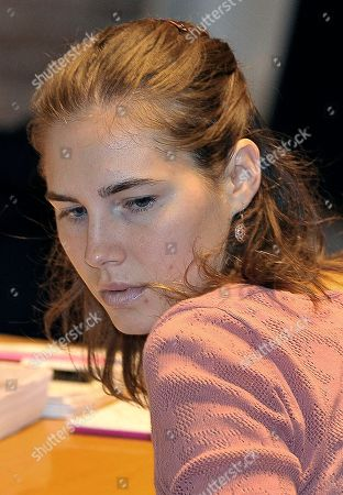 """Deanna Knox, Curt Knox Amanda Knox, the American student convicted of killing her roommate, is seen at a court in Perugia, Italy, . A defense lawyer has told a court to see Amanda Knox, the American student convicted of killing her roommate, not as the """"femme fatale"""" her accusers describe but rather as a loving young woman"""