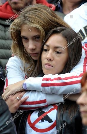 Stock Image of MotoGp rider Marco Simoncelli's girlfriend Kate Fretti, right, is embraced by Simoncelli's sister Martina as they leave the Santa Maria church, at the end of the funeral service of Simoncelli, in his hometown of Coriano, Italy, . Italian sport was in shock after Marco Simoncelli died following a crash at the Malaysian MotoGP motorcycle race. He was 24. Simoncelli - nicknamed Sic or SuperSic - died of chest, head and neck injuries Sunday after he lost control of his Honda at turn 11, four minutes into the race, and swerved across the track, straight into the path of American rider Colin Edwards and Valentino Rossi of Italy