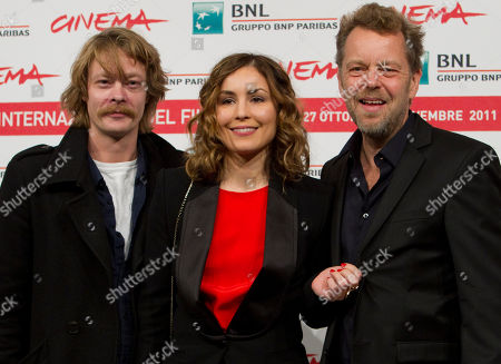 "From left, Norwegian actor Kristoffer Joner, Swedish actress Noomi Rapace and Norwegian director Pal Sletaune pose during the photo call of the movie ""Babycall"", at the 6th edition of the Rome International Film Festival in Rome"
